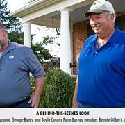 Director of Claims for KFB Insurance, George Bates, and Boyle County Farm Bureau member, Bennie Gilbert, anxiously await their close-up.