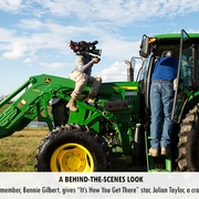 "Boyle County Farm Bureau member, Bennie Gilbert, gives ""It's How You Get There"" star, Julian Taylor, a crash-course in tractor driving."